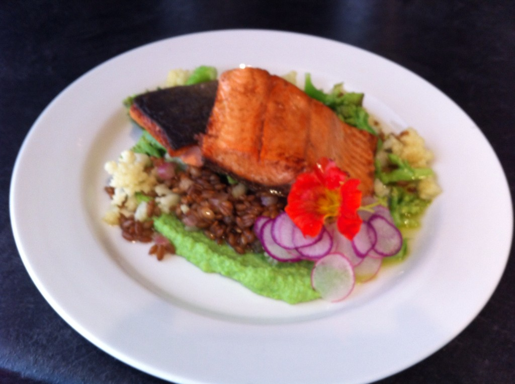 Chef Mary Reilly's Butter basted sockeye salmon with rye berries, cauliflower and romanesco, broccoli, sweet pea puree. Enzo Restaurant & Bar in Newburyport, MA