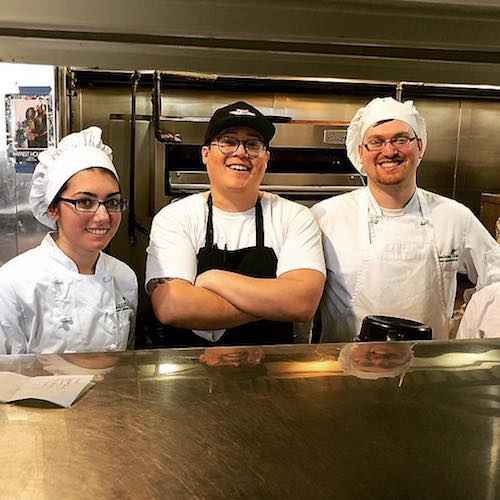 Culinary students in restaurant kitchen